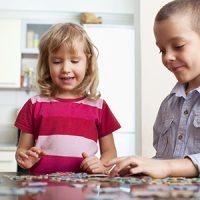 2 children doing a puzzle